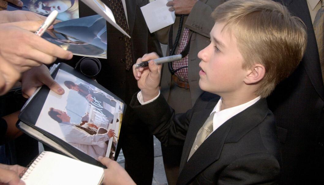 <strong>MEGET POPULÆR:</strong> Den unge stjerna signerte ofte autografer, og var å se på rød løper flere ganger i året. Så trakk han seg tilbake. Foto: NTB Scanpix