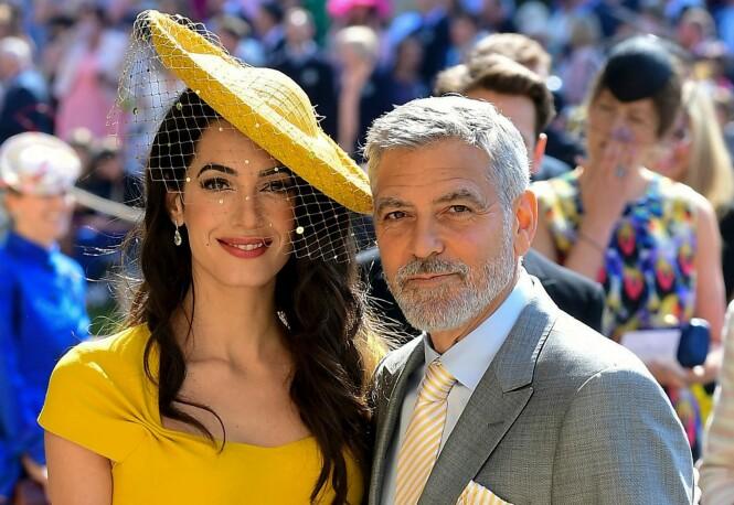 BRYLLUP: George og Amal Clooney i bryllupet til hertigunne Meghan og prins Harry i mai i fjor. Foto: NTB Scanpix