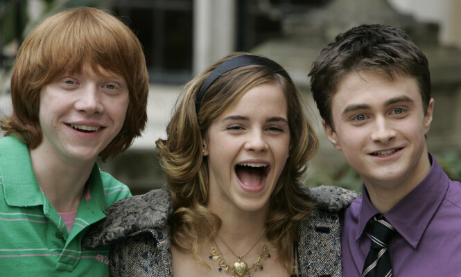VERDENSKJENTE: Etter at den første Harry Potter-filmen ble vist på skjermen, ble Rupert Grint, Emma Watson og Daniel Radcliffe stjerner over natten. Her er stjernetrioen fotografert sammen i 2005. Foto: NTB scanpix