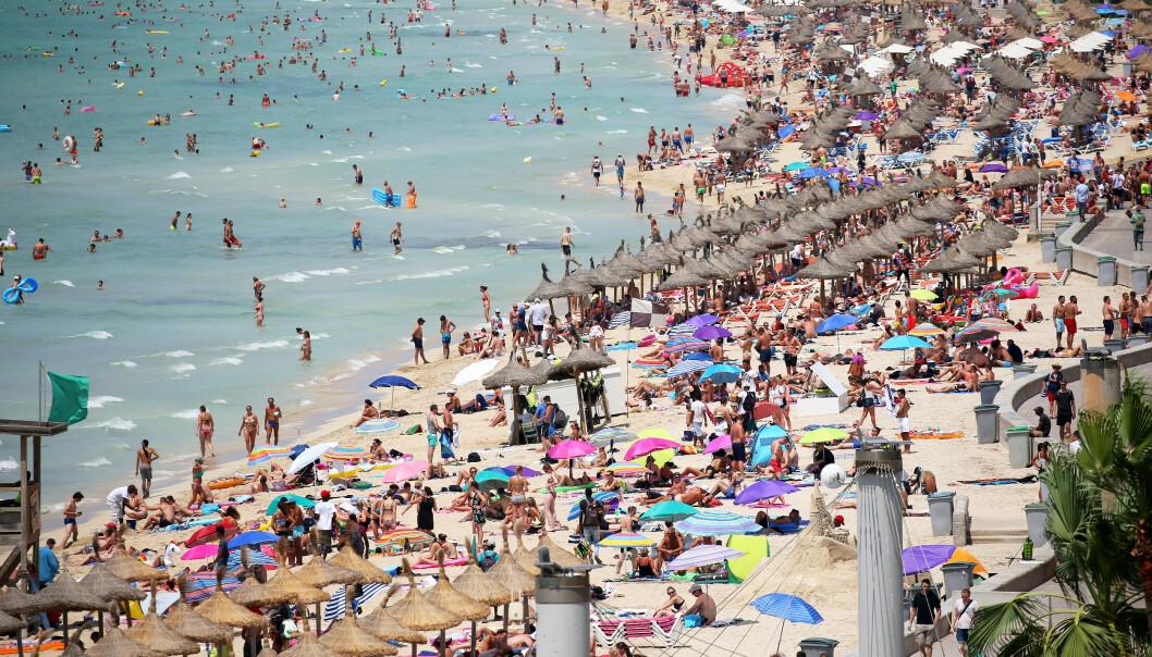 <strong>I FARE:</strong> De populære strendene på Mallorca står i fare for å bli vasket bort av det stigende havet, sier forsker. Fram mot århundreskiftet kan mer enn halvparten av strendene bli borte, spår forsker. Foto: NTB Scanpix