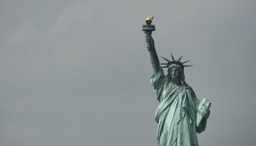 <strong>FRIHETSGUDINNEN:</strong> Det ikoniske landemerket i New York står i fare for å rammes av stigende havnivå og mer ekstremvær. Foto: NTB Scanpix