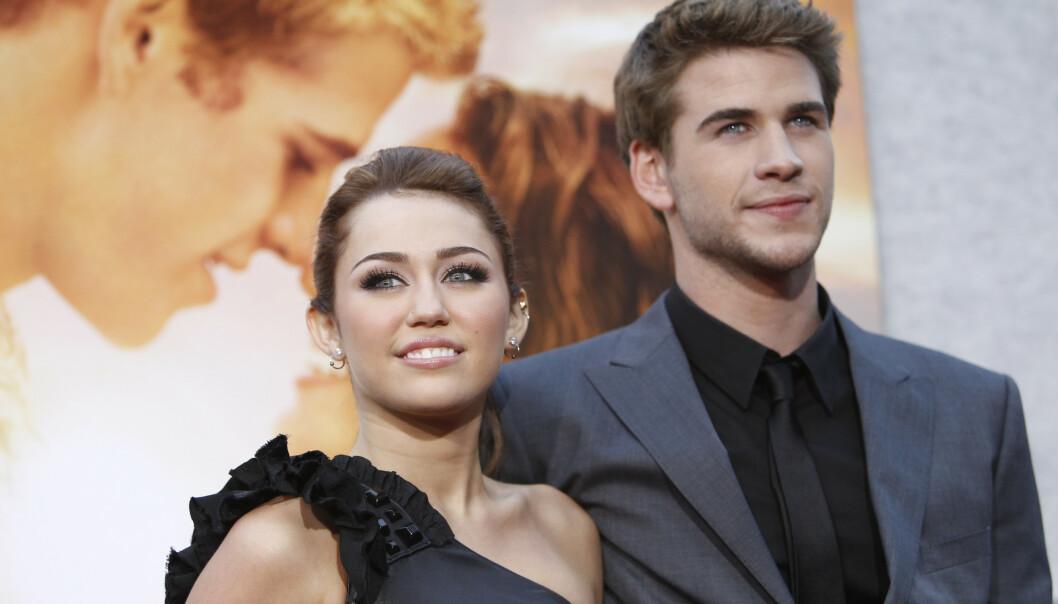 <strong>TI ÅR:</strong> Miley og Liam møttes i 2009, under innspillingen av filmen «The Last Song». Her avbildet på en premiere i 2010. Foto: NTB Scanpix
