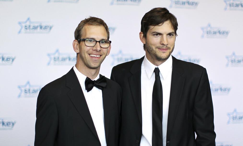 <strong>ILDSJELER:</strong>Tvillingbrødrene Michael (t.v.) og Ashton Kutcher føler begge at de på hver sin måte har vært heldige i livet. Nå bruker de mye tid på veldedig arbeid for å vekke engasjement hos andre. Foto: Getty Images