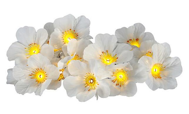 BLOMSTERSLYNGE: En fin lysdekorasjon med blomster som skrur seg på når det mørkner.