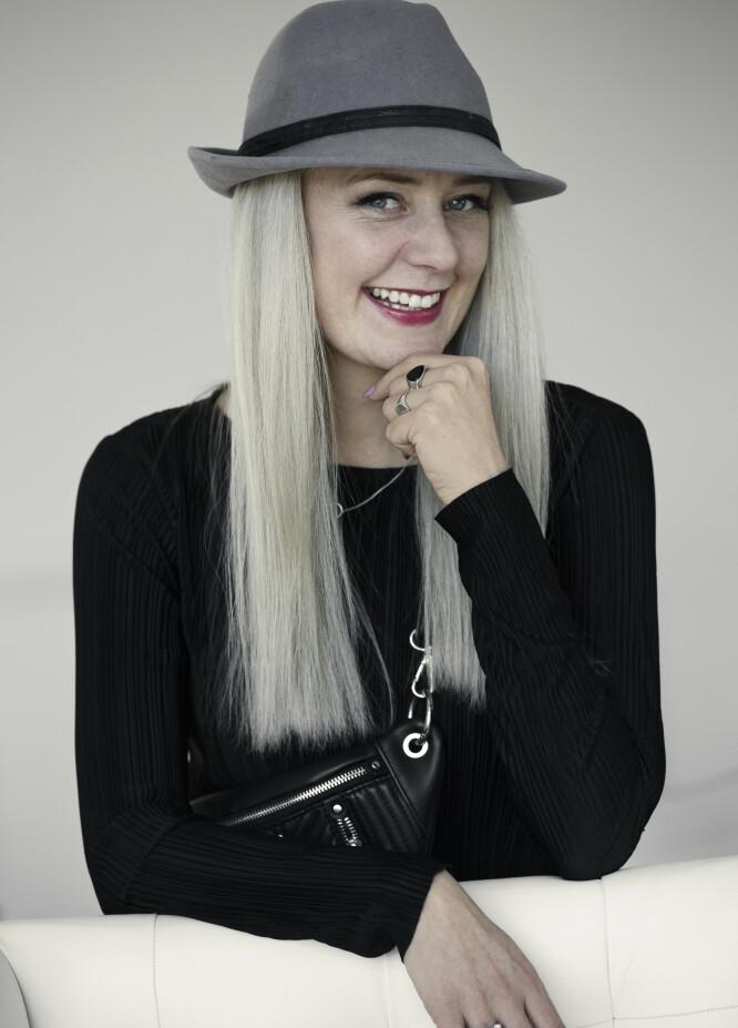 HOLDER MAMMA I TØYLENE: Christinah har overtatt styrelederplassen i Nikita-kjeden. FOTO: Astrid Waller.