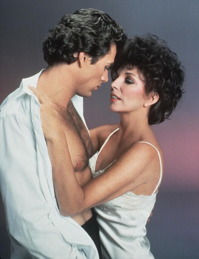 PAR I HJERTER: Jon-Erik Hexum og Joan Collins fra «Dynastiet» var ofte foran kamera sammen. Her fra TV-serien «Making Of A Male Model» i 1983. FOTO: NTB Scanpix