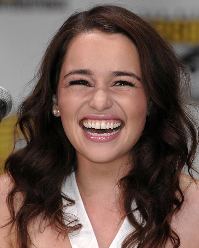 GODT HUMØR: Skuespiller Emilia Clarke er kjent for sitt blide vesen og sprudlende humør. Her er hun i 2011. Foto: AP/ NTB Scanpix