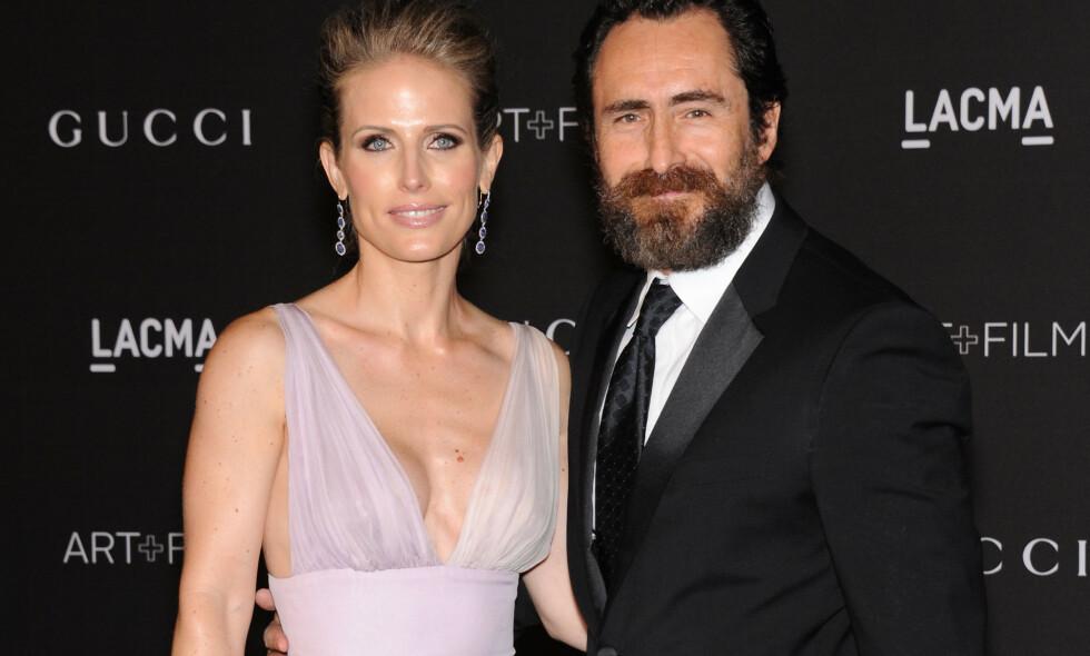 GIKK BORT: Modell og skuespiller Stefanie Sherk, som var gift med Hollywood-skuespiller Demian Bichir, er død. Det avslører ektemannen i et rørende innlegg på Instagram. Her er paret sammen på rød løper i 2014. Foto: NTB scanpix