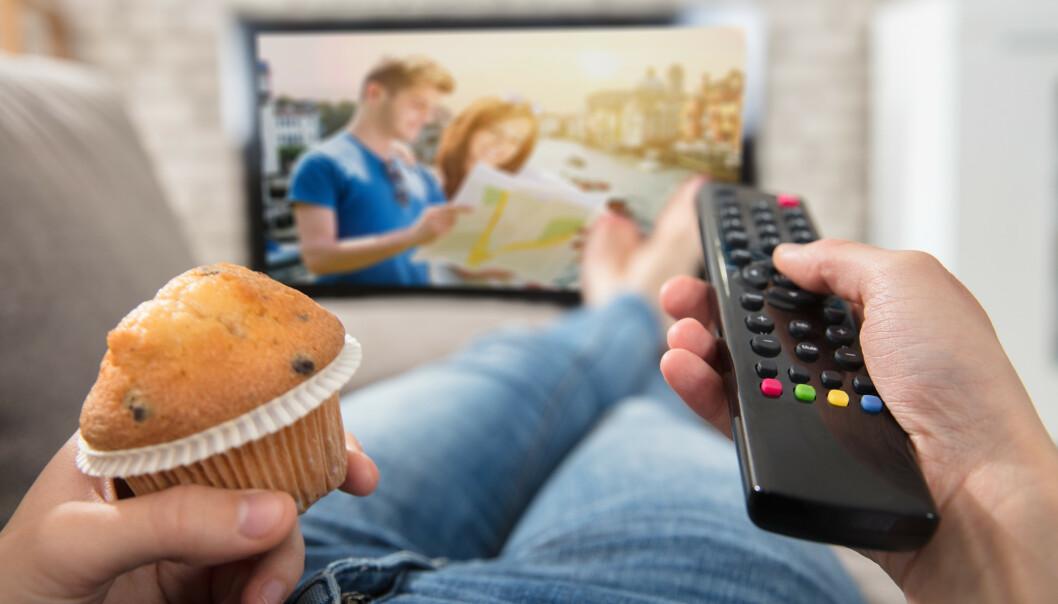 PÅVIRKER LYSTEN PÅ NOE SØTT: Romantiske filmer er koselige, og mange forbinder kos med usunn og søt mat. FOTO: NTB Scanpix