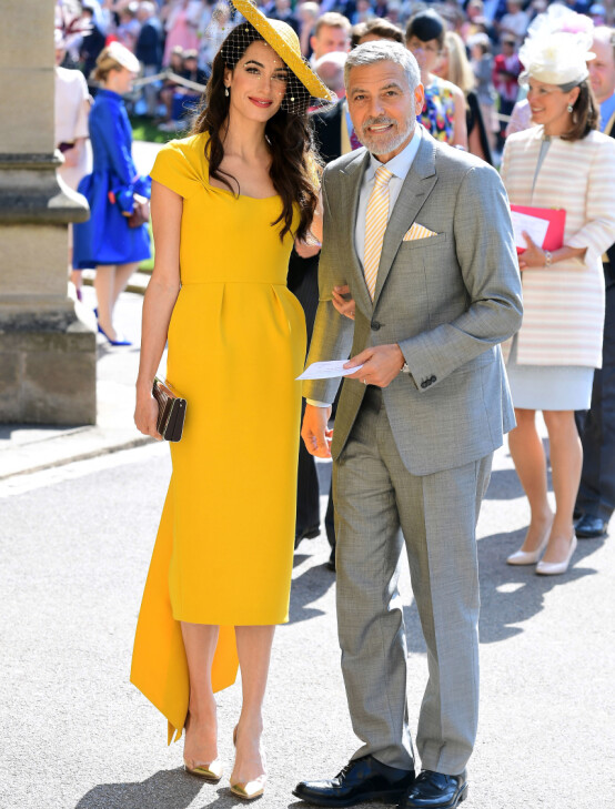 BRYLLUPSGJESTER: Amal og George Clooney strålte side om side da prins Harry og Meghan Markle giftet seg i Windsor 19. mai 2018. Foto: REX/ NTB scanpix