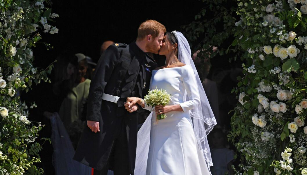 <strong>MIDTPUNKTET:</strong> Bryllupet og dette kysset ble sett av millioner verden over. Foto: NTB Scanpix