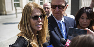 "FILE- In this April 13, 2018 file photo, actress Catherine Oxenberg, left, talks to the media following the arraignment of NXIVM leader Keith Raniere at federal court in New York. Oxenberg has been one of NXIVM's most vocal opponents. Her daughter, India, is a former NXIVM member who once revealed to her mother she had been branded with Raniere's initials and considered it ""character building."" (AP Photo/Kevin Hagen, File)"