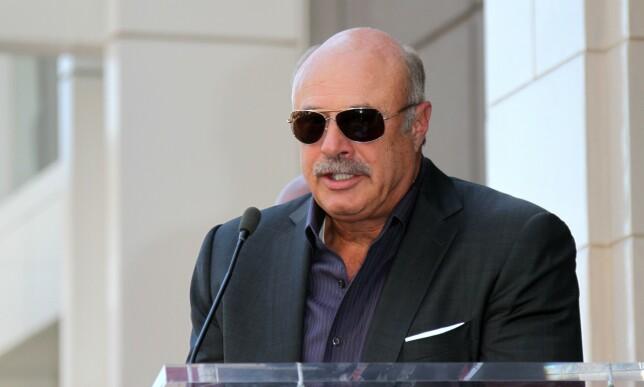 POPULÆR: Til tross for de mange anklagene mot ham, er det liten tvil om at Dr Phil er populær. Tv-programmet har vært vist på skjermen i hele 17 år og i 2013 fikk han også sin egen stjerne på «Hollywood Walk of Fame». Foto: NTB Scanpix