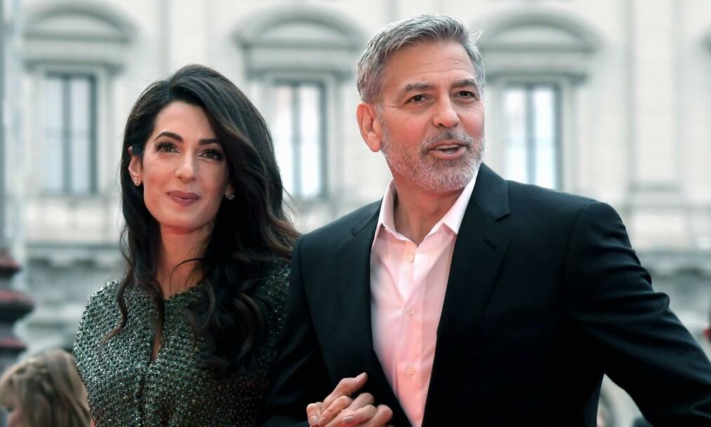<strong>BRUKER SEG SELV:</strong> Er man heldig kan man nå dra på date med George og Amal Clooney. Foto: NTB Scanpix