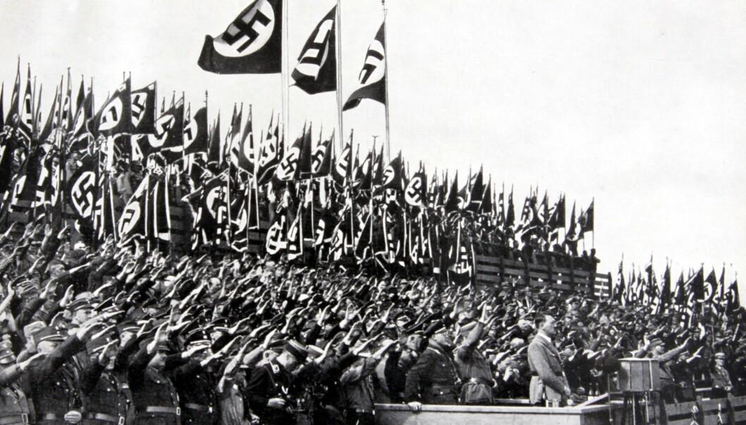 <strong>NASJONALFLAGG:</strong> Svastikaen var del av Tysklands nasjonalflagg i perioden 1933-45. Her fra NSDAPs partikongress i Nürnberg i 1935, der de antisemittiske Nürnberg-lovene ble vedtatt. Foto: Rex Shutterstock / NTB Scanpix