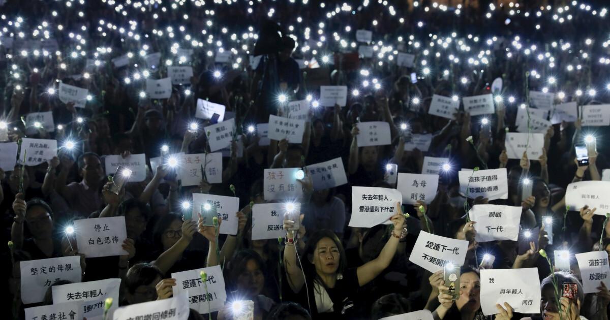 Hongkongs leder skrinlegger omstridt lovforslag som har utløst store demonstrasjoner