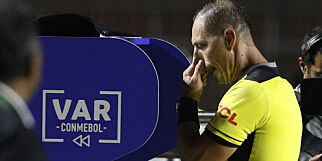 Referee Nestor Pitana looks at the VAR before awarding a penalty kick for Brazil during a Copa America Group A soccer match against Bolivia at the Morumbi stadium in Sao Paulo, Brazil, Friday, June 14, 2019. (AP Photo/Victor Caivano)