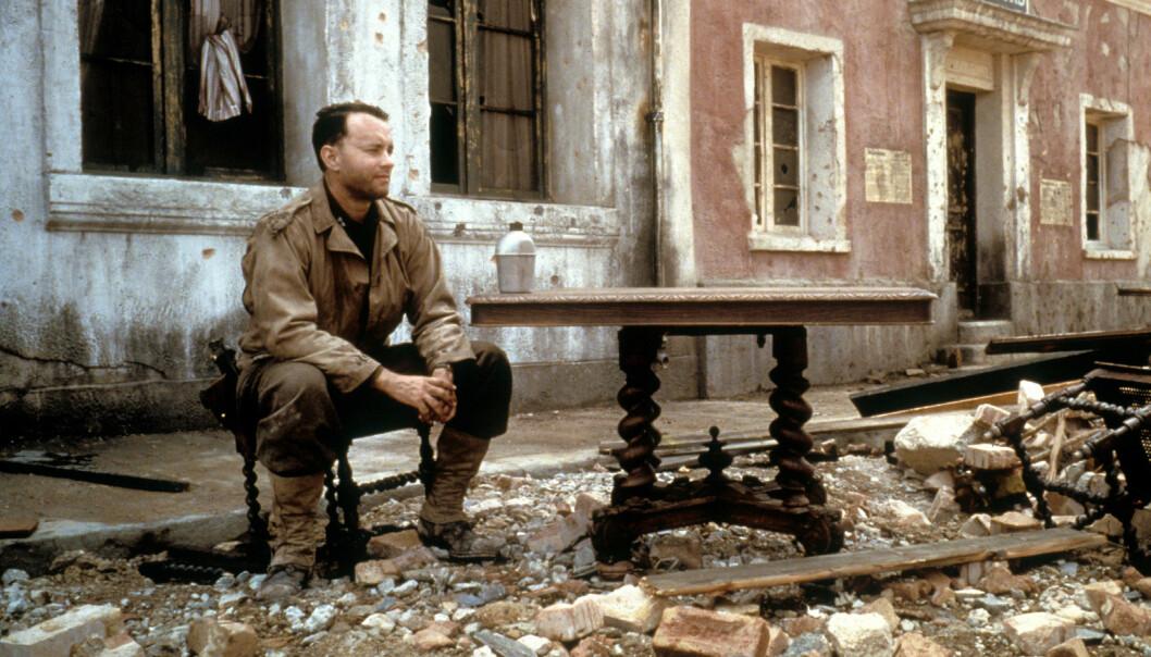 <strong>KRIGSFILM:</strong> Tom Hanks bestemte seg tidlig for at han ikke ville settes i bås og bare spille romantiske komedier. Her fra krigsfilmen «Saving Private Ryan». Foto: NTB Scanpix