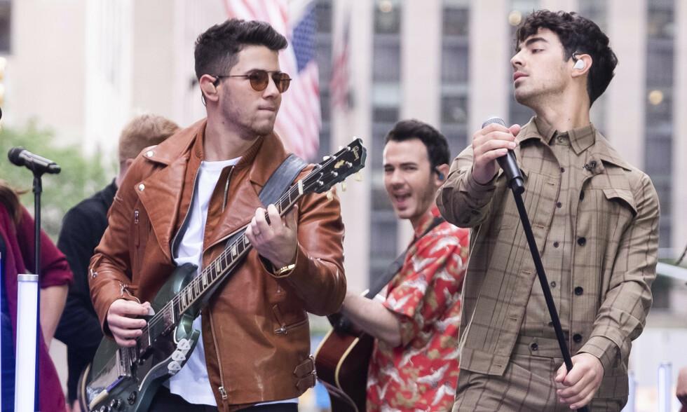 SUKSESS: The Jonas Brothers, bestående av Nick, Kevin og Joe Jonas, har oppnådd stor suksess som artister. Også på privaten har de lykkes. Foto: NTB Scanpix