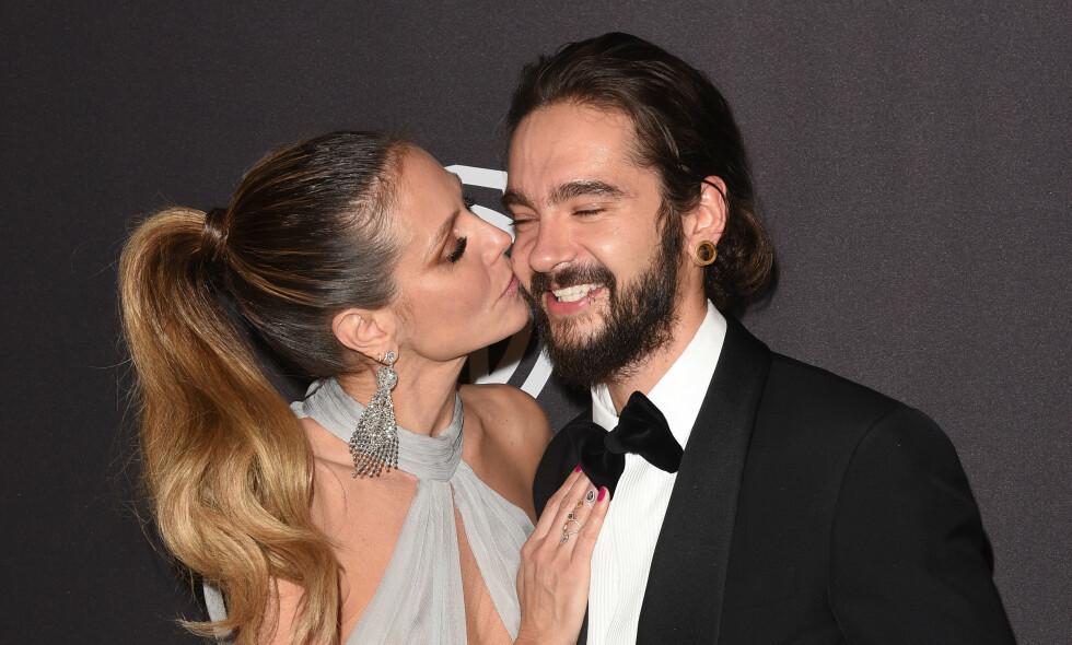 GIFT: Supermodellen Heidi Klum og Tokio Hotel-gitaristen Tom Kaulitz skal ha giftet seg i all hemmelighet. Førstnevntes antrekk på bryllupsdagen var imidlertid noe annerledes enn de fleste. Foto: NTB Scanpix