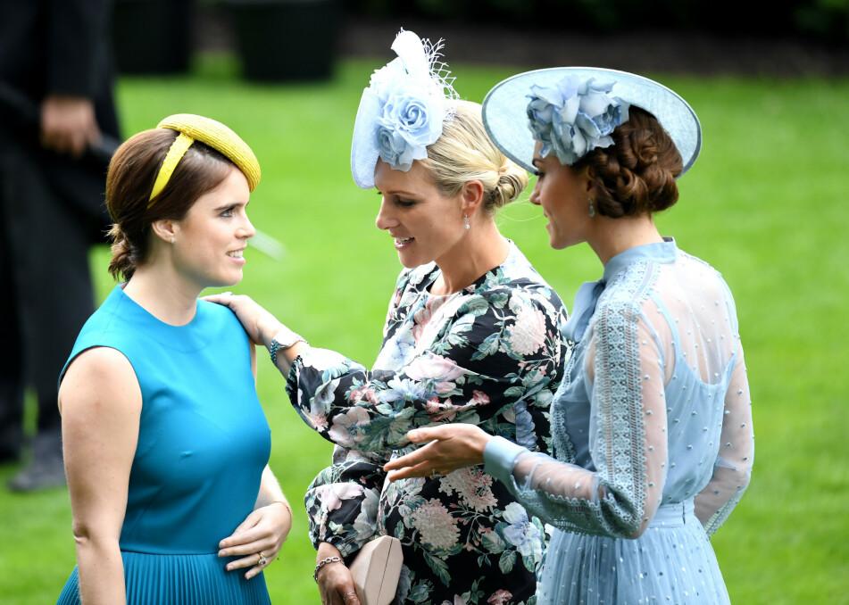 SATTE FART PÅ RYKTENE: Bildet av prinsesse Eugenie i samtale med kusinen Zara Tindall og fetterens kone hertuginne Kate, under Royal Ascot i juni, satte fart på gravidryktene. FOTO: NTB Scanpix