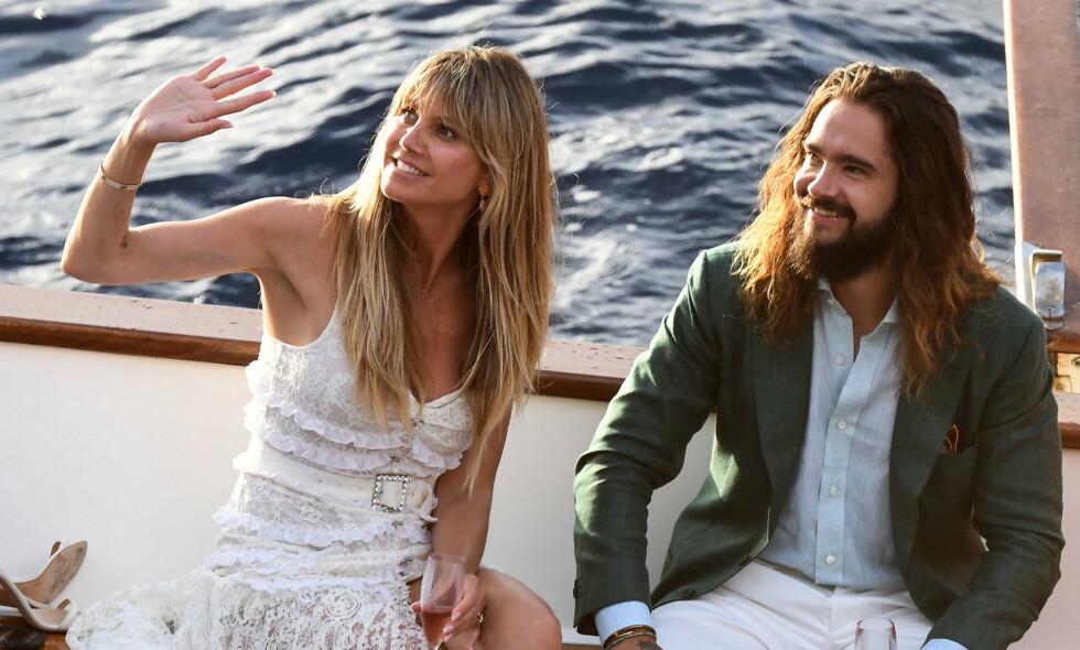 NYGIFT: I starten av august giftet Heidi Klum og Tom Kaulitz seg for andre gang. Nå viser det seg at de har brutt italiensk lov under oppholdet, og kan dermed vente seg en saftig bot. Foto: NTB Scanpix