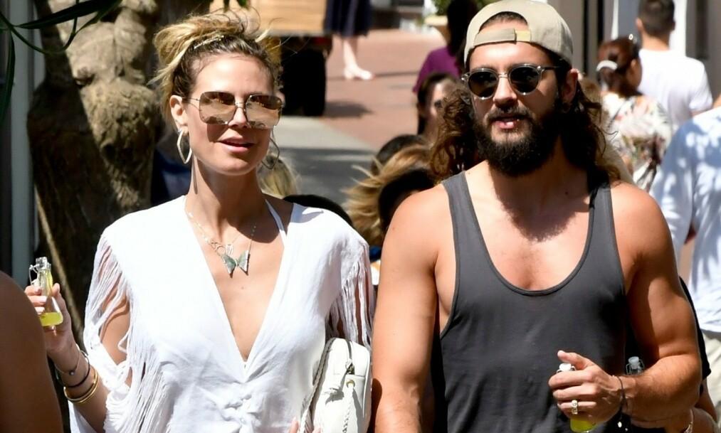 NYGIFTE: Heidi Klum og ektemannen Tom Kaulitz befinner seg for tiden på bryllupsreise. Men det er ikke alle bildene modellen deler fra turen som faller i god jord hos fansen. Her er paret avbildet kort tid før bryllupsfeiringen på Capri nylig. Foto: NTB Scanpix