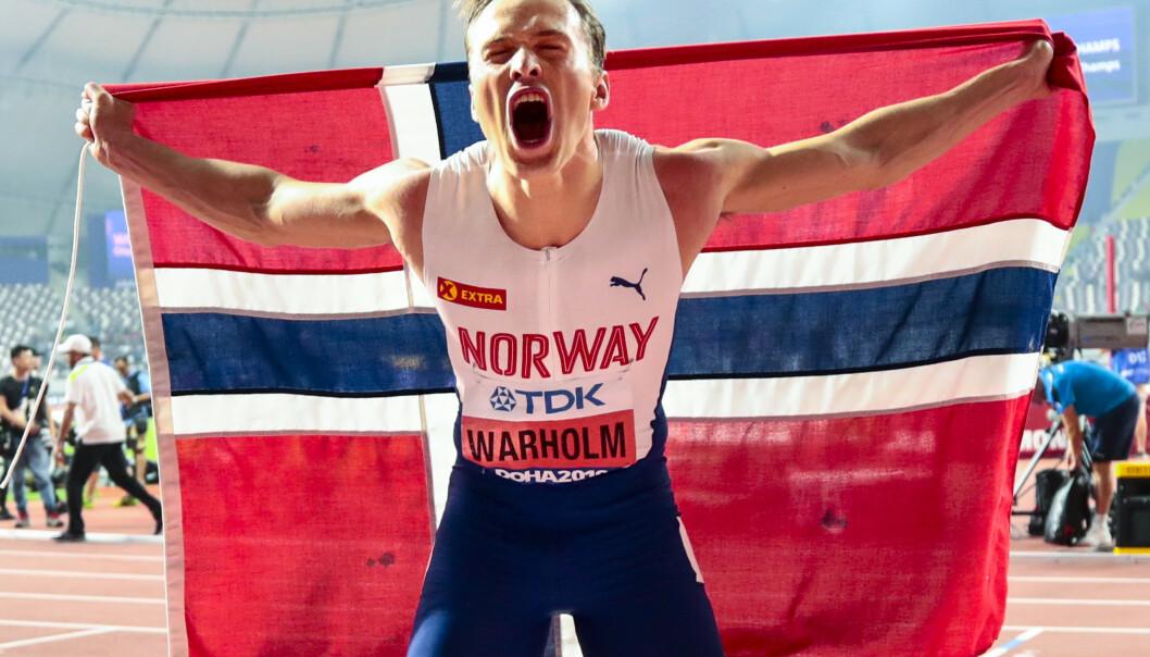 <strong>JUBEL:</strong> Karsten Warholm jublet for VM-gull etter finalen på 400 meter hekk under VM i friidrett 2019. Foto: NTB Scanpix