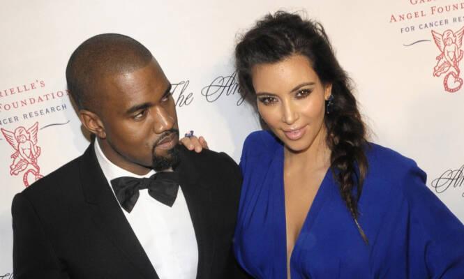 KJÆRESTER: Kim og Kanye begynte å date i 2012. Det var ikke alle like begeistret for. Her er ekteparet avbildet sammen på rød løper samme år. Foto: NTB Scanpix