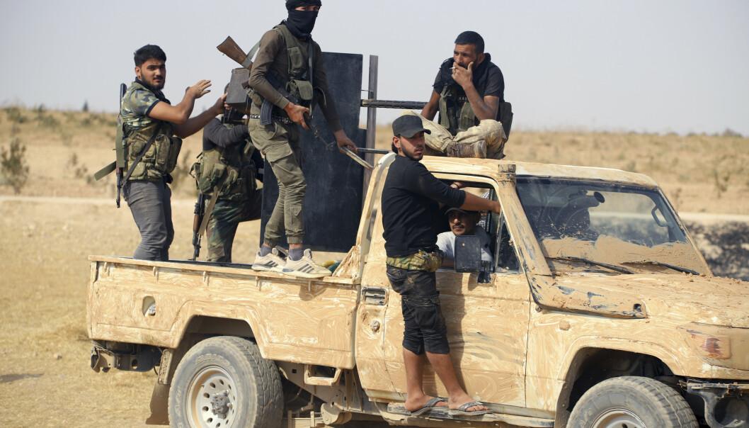 Tyrkiskstøttede militssoldater deltar i Tyrkias forsøk på å etablere en såkalt sikkerhetssone nordøst i Syria. Foto: AP / NTB scanpix