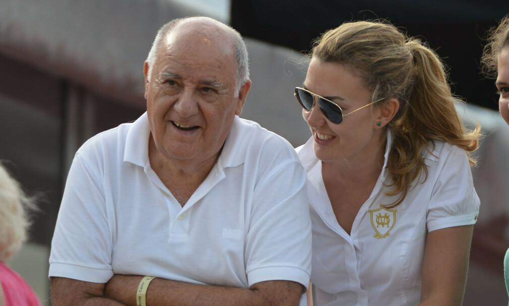 ULTRARIKE: Den spanske forretningsmannen Amancio Ortega (84) har gjort seg styrtrik på klær. Han har indikert at kvinnen til høyre en dag skal overta alt. Foto: NTB Scanpix