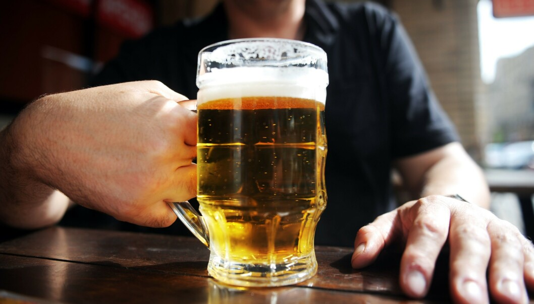 (FILES) In this file photo taken on August 26, 2011 a man drinks a beer in a Moscow's outdoor pub. - Russia might still have a reputation as a nation of hard drinkers, but a report by the World Health Organization published on October 1, 2019 showed alcohol consumption has dropped by 43 percent since 2003. The WHO put the decrease down to a raft of measures brought in under sport-loving President Vladimir Putin, including restrictions on alcohol sales and the promotion of healthy lifestyles. (Photo by DMITRY KOSTYUKOV / AFP)