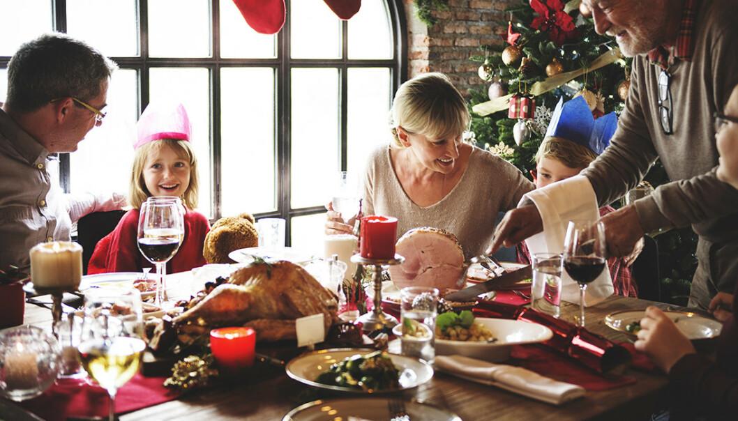IDYLL? Julemiddagen er sjelden så fredfull som den ser ut på bilder. Men med enkle grep kan du unngå krangling og ufred. Foto: Shutterstock