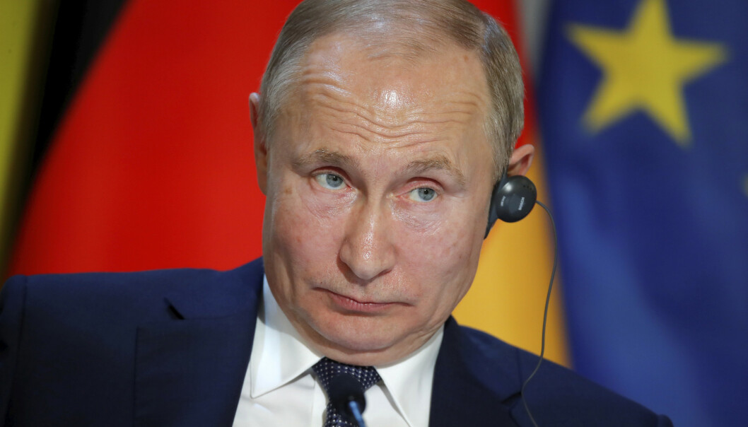 Russlands president Vladimir Putin sier ifølge nyhetsbyrået DPA at den georgiske mannen som ble drept i Berlin i august, var en «blodtørstig» og «brutalt» menneske. Foto: AP / NTB scanpix