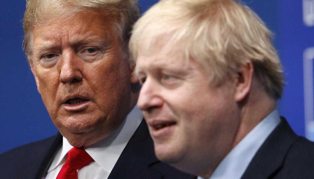 <strong>- MASSIV AVTALE:</strong> USAs president Donald Trump gratulerer Storbritannias Boris Johnson med valgseieren og sier landene nå vil kunne inngå en «massiv» handelsavtale. Foto: Peter Nicholls / AP / NTB Scanpix