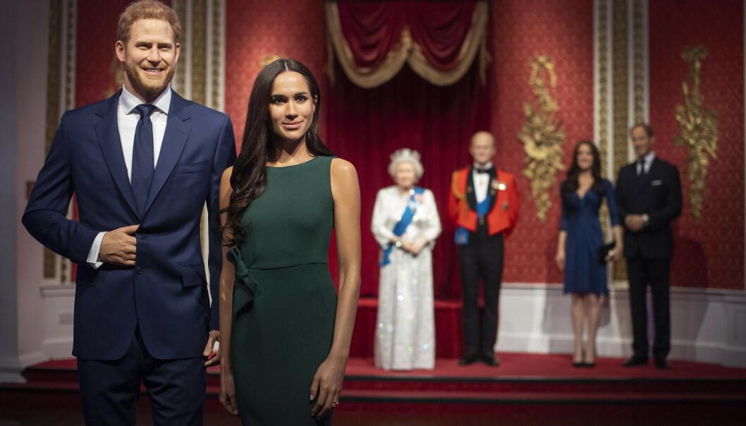 <strong>FLYTTET:</strong> Voksfigurene av prins Harry og hertuginne Meghan er nå flyttet bort fra resten av kongefamilien - som følge av deres overraskende kunngjøring om å trekke seg tilbake fra sitt kongelige liv. Foto: NTB Scanpix