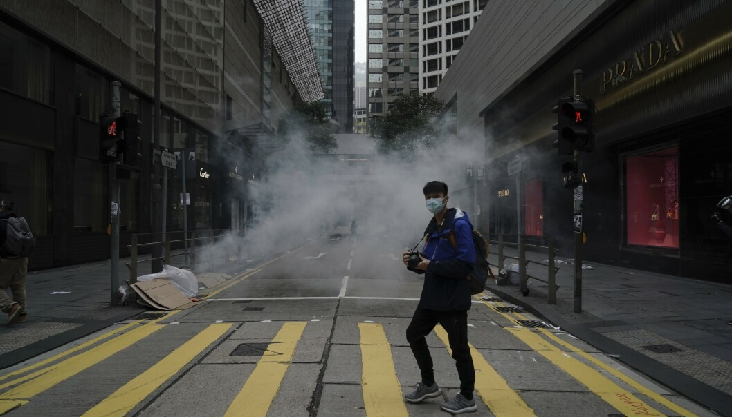 <strong>NEDJUSTERER:</strong> Moody's etterlyser en plan for å håndtere uroen i Hongkong og nedjusterer territoriets kredittvurdering. Arkivfoto: Kin Cheung / AP / NTB scanpix
