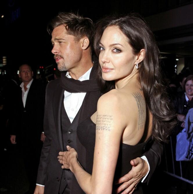 FANT HVERANDRE: Brad Pitt og Angelina Jolie i 2005, samme året som han skilte seg fra Jennifer Aniston. Foto: NTB Scanpix