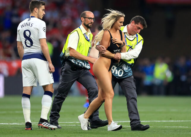 *EDITORS NOTE NUDITY* Pitch invader Kinsey Wolanski is excorted from the pitch during the UEFA Champions League Final at the Wanda Metropolitano, Madrid.