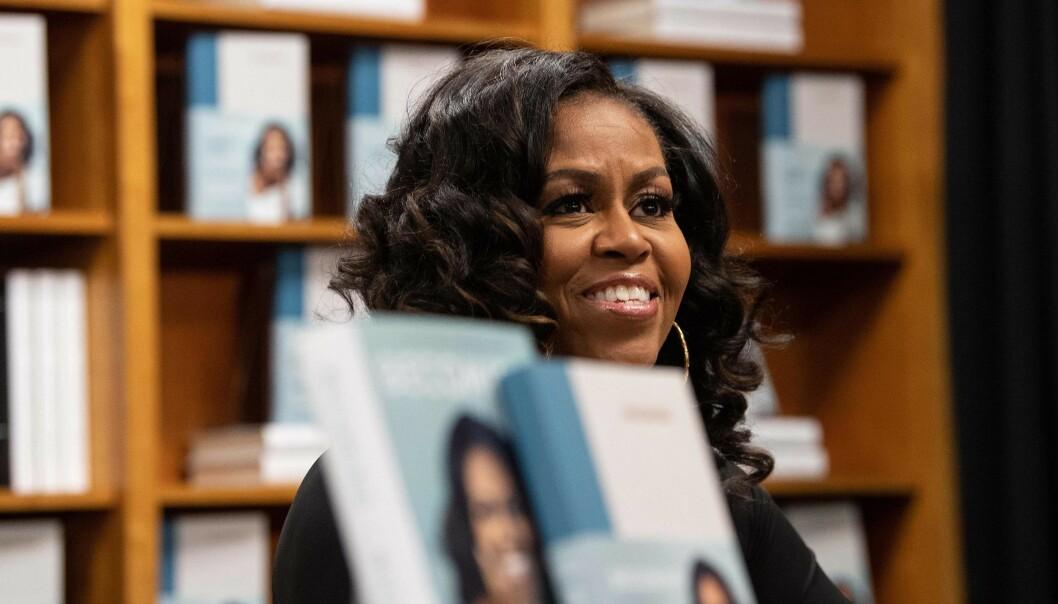 TRENING: Det er ingen hemmelighet at Michelle Obama elsker å holde seg i form - gjerne da med denne musikken på øret! FOTO: NTB scanpix