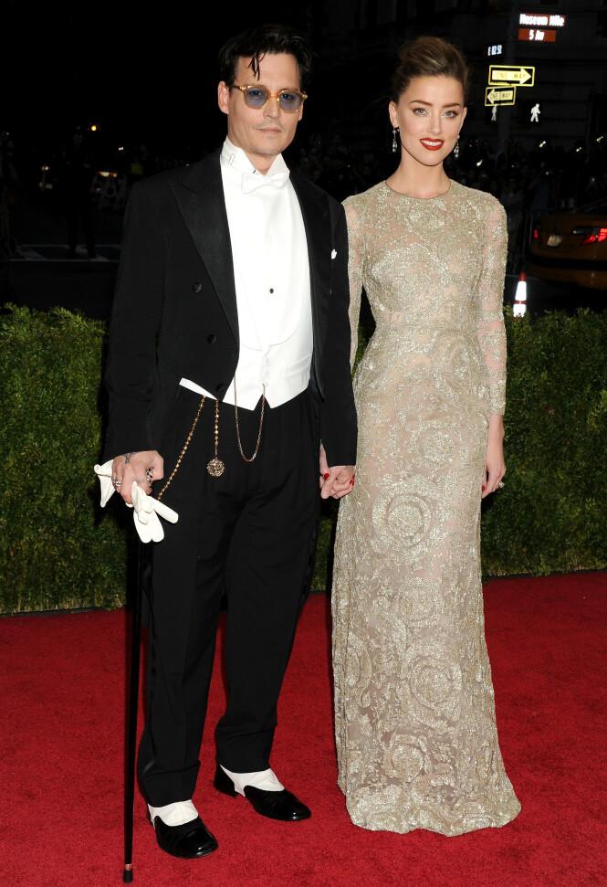 FØR ANKLAGENE: Johnny Depp og Amber Heard på den røde løperen i 2014. Foto: NTB Scanpix