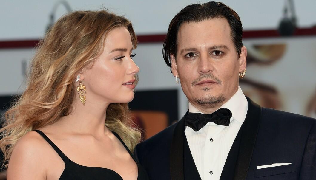 TURBULENT: Det er ingen tvil om at skilsmissen mellom stjerneparet Amber Heard og Johnny Depp var svært turbulent. Nå har det imidlertid kommet frem et lydopptak fra eksparets ekteskap hvor Heard skal ha innrømmet å ha vært voldelig mot Depp. Her er duoen avbildet i 2015. Foto: NTB Scanpix
