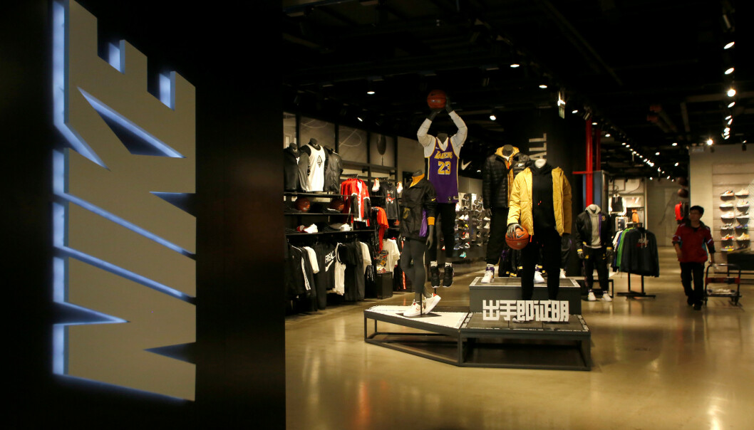 <strong>FILE PHOTO:</strong> A Nike store selling NBA Los Angeles Lakers sportswear is seen in Beijing, China October 10, 2019. REUTERS/Tingshu Wang/File Photo