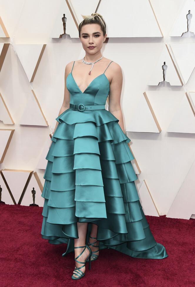 <strong>OPPSIKTSVEKKENDE:</strong> «Midsommar»-skuespiller Florence Pugh var ikke akkurat usynlig på løperen i denne kjolen fra Louis Vuitton. Foto: NTB scanpix