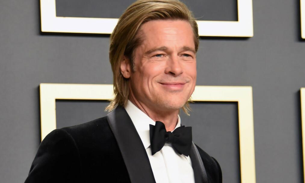 <strong>LATTERLIGGJØRES:</strong> Brad Pitt stakk av med en Oscar under årets utdeling, men det er kanskje håret hans som har vekket størst oppsikt. Foto: NTB scanpix