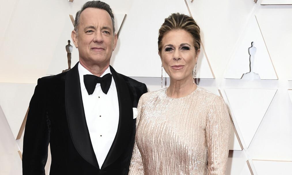 <strong>SMITTET:</strong> Tom Hanks og kona Rita Wilson avbildet under Golden Globes-utdelingen i januar i år. Foto: AP/ NTB scanpix