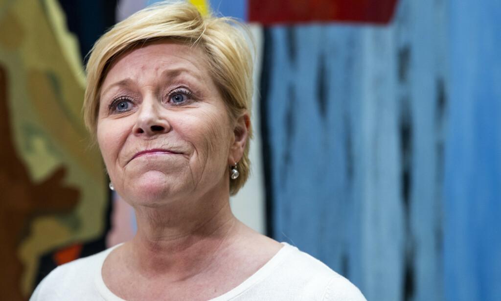 SVARER: Frp-leder Siv Jensen reagerer sterkt på KrFs kampanje for å snu Frp-representanter i spørsmålet om bioteknologi. Foto: Terje Pedersen / NTB Scanpix
