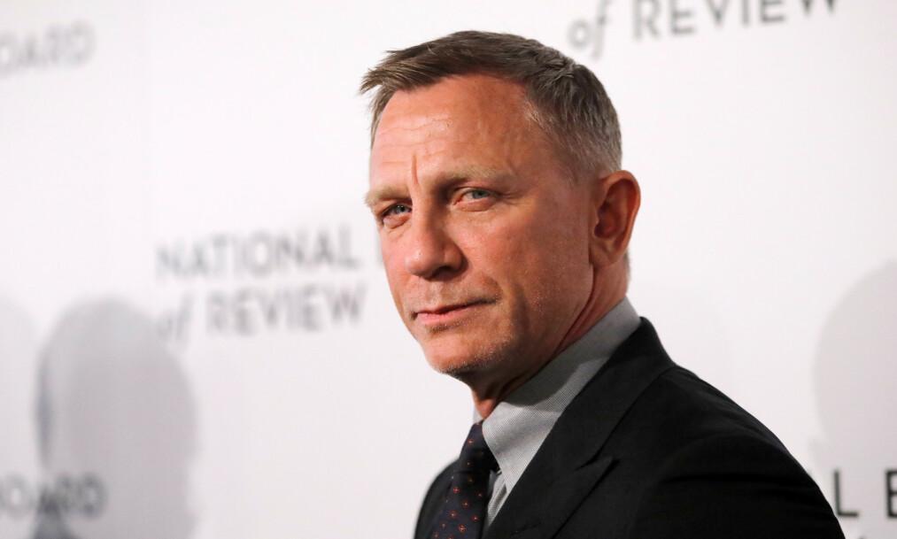 <strong>GNIEN:</strong> Daniel Craig forteller at han ikke har planer om å etterlate milliardformuen til barna sine. Han mener arv som konsept er usmakelig. Foto: NTB scanpix