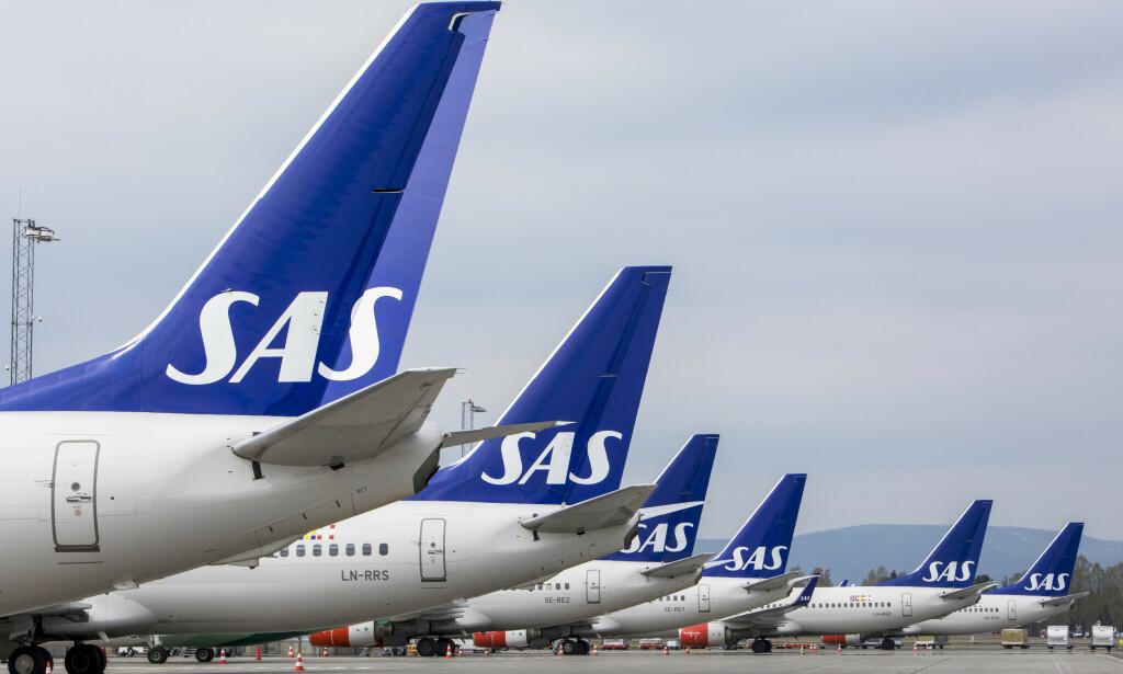 PÅ BAKKEN: Mange SAS-fly er parkert i disse dager.    Foto: Ole Berg-Rusten / NTB Scanpix