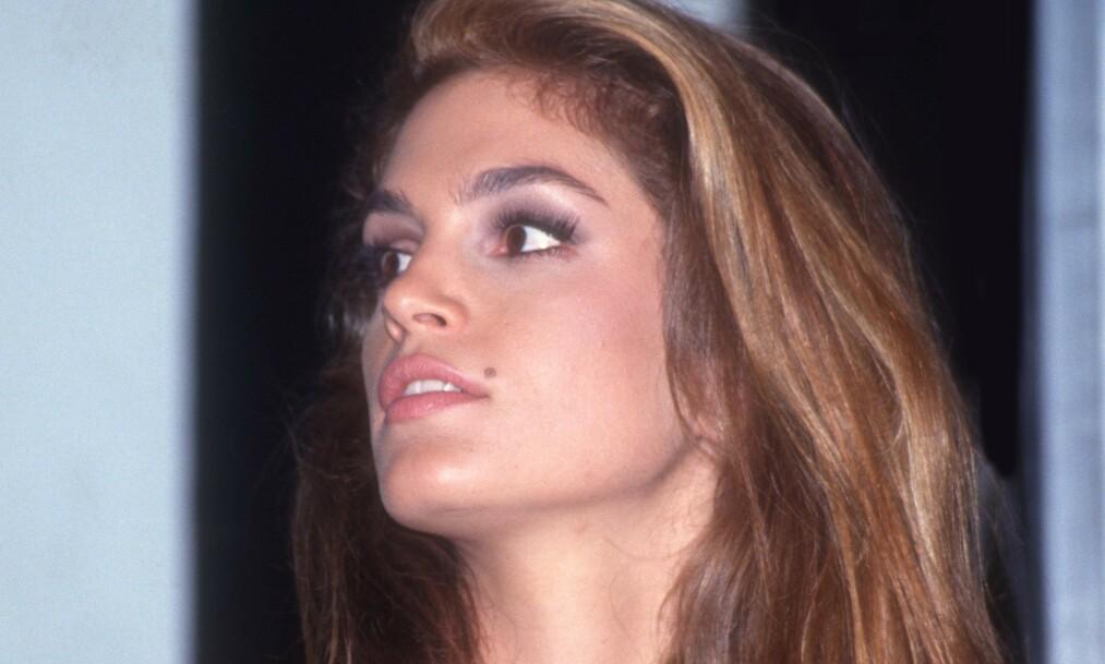 <strong>KJENNEMERKE:</strong> Da hun slo gjennom som modell fikk Cindy Crawford beskjed om at skjønnhetsflekken kunne hindre henne i å få jobb. Her er hun avbildet i 1991. Foto: NTB Scanpix